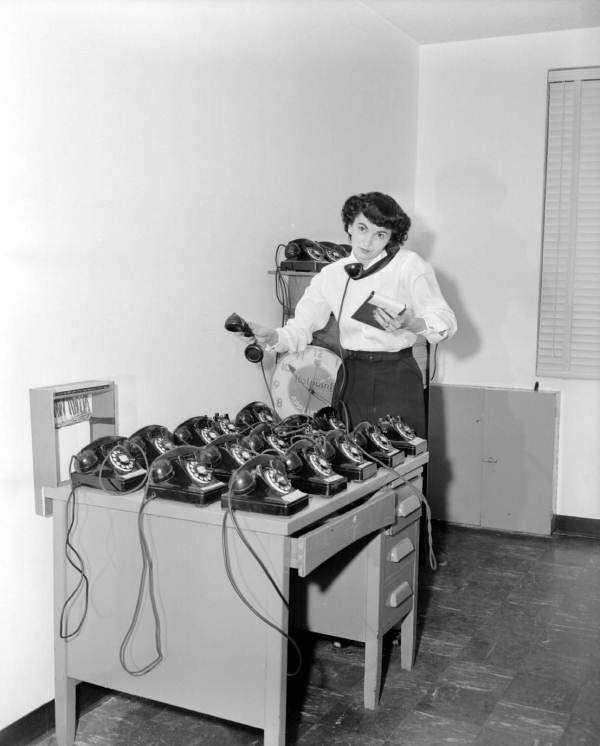 Mrs. Red Taylor with desk full of phones