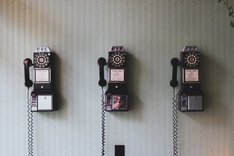 Three Payphones Hung on a Wall
