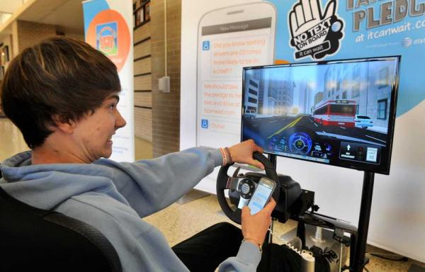 Student experiencing a distracted driving simulation. Photo courtesy Michael Schumacher, Amarillo Globe-News